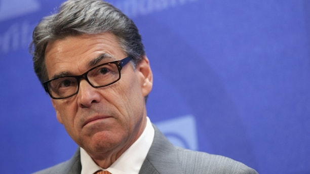 WASHINGTON, DC - AUGUST 21:  Texas Governor Rick Perry delivers remarks about immigration and the need for more aggressive enforcement along the Texas-Mexico border at the conservative think tank The Heritage Foundation August 21, 2014 in Washington, DC. The governor of Texas since 2000 and a one-time presidential candidate, Perry was recently indicted by a Travis County grand jury for abuse of power and coercion of a public servant after he vetoed $7.5 million in funding for the state's Public Integrity Unit, which is investigating Perry's Cancer Prevention and Research Institute of Texas.  (Photo by Chip Somodevilla/Getty Images)