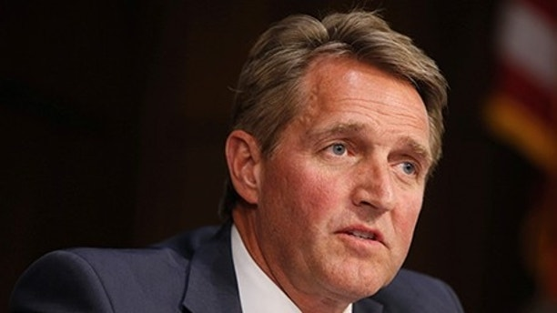 Senator Jeff Flake (R-AZ) questions Supreme Court nominee judge Neil Gorsuch during his Senate Judiciary Committee confirmation hearing on Capitol Hill in Washington, U.S., March 21, 2017. REUTERS/Joshua Roberts - RTX322MM