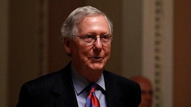 Senate Majority Leader Mitch McConnell walks to his office prior to an all night round of health care votes on Capitol Hill in Washington, U.S., July 27, 2017. REUTERS/Aaron P. Bernstein - RTX3D88E