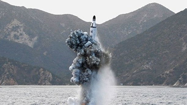 North Korean leader Kim Jong Un guides on the spot the underwater test-fire of strategic submarine ballistic missile in this undated photo released by North Korea's Korean Central News Agency (KCNA) in Pyongyang on April 24, 2016. KCNA/via REUTERS. ATTENTION EDITORS - THIS IMAGE WAS PROVIDED BY A THIRD PARTY. EDITORIAL USE ONLY. REUTERS IS UNABLE TO INDEPENDENTLY VERIFY THIS IMAGE. SOUTH KOREA OUT.           TPX IMAGES OF THE DAY      - RTX2BDTM