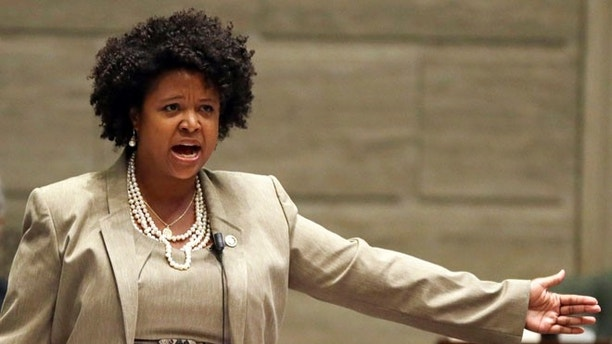 FILE - In this Sept. 10, 2014, file photo, Missouri state Sen. Maria Chappelle-Nadal speaks on the Senate floor in Jefferson City, Mo. Chappelle-Nadal says she posted and then deleted a comment on Facebook that said she hoped for President Donald Trump's assassination. The Democratic Senator says she didn't mean what she posted Thursday, Aug. 17, 2017, but was frustrated with the president's reaction to the violence last weekend in Charlottesville, Va.(AP Photo/Jeff Roberson, File)