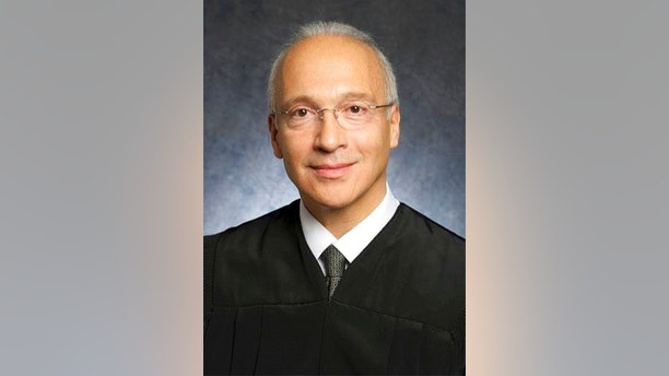 FILE - This undated file photo provided by the U.S. District Court shows Judge Gonzalo Curiel. Lawyers for a Mexican man who was shielded from being deported will try to persuade Curiel, who has been a target of President Donald Trump's scorn, that the administration wrongly expelled their client from the United States. Juan Manuel Montes, 23, is the first known recipient of the five-year-old Deferred Action for Childhood Arrivals program to be deported under Trump. Curiel will hear arguments Tuesday, Aug. 22, 2017. (U.S. District Court via AP, File)