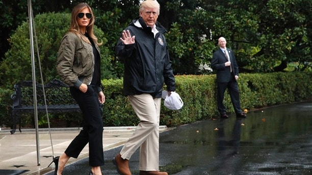 President Donald Trump accompanied by first lady Melania Trump waves as they walk from the White House to the South Lawn Tuesday Aug. 29 2017 to board Marine One for a short trip to Andrews Air Force Base Md.m then onto Texas to view the federal