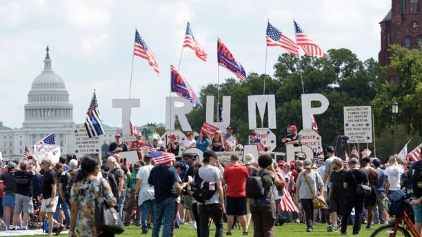 "People gather on the National Mall in Washington, Saturday, Sept. 16, 2017, to attend a rally in support of President Donald Trump in what organizers are calling 'The Mother of All Rallies."" (AP Photo/Susan Walsh)"