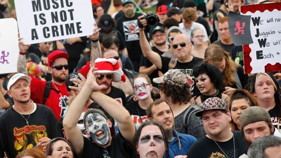 "Juggalos, as supporters of the rap group Insane Clown Posse are known, gather in front of the Lincoln Memorial in Washington during a rally, Saturday, Sept. 16, 2017, to protest and demand that the FBI rescind its classification of the juggalos as ""loosely organized hybrid gang."" (AP Photo/Pablo Martinez Monsivais)"