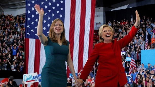 U.S. Democratic presidential nominee Hillary Clinton and her daughter Chelsea wave to the crowd at a campaign rally in Raleigh, North Carolina, U.S. November 8, 2016.  REUTERS/Brian Snyder  - D1BEULPKWUAA