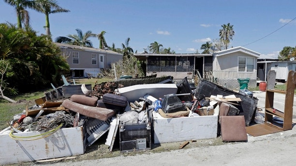 A pile of debris caused by storm surge during Hurricane Irma, Monday, Sept. 18, 2017, in Everglades City, Fla. The isolated Everglades City community of about 400 people suffered some of Florida's worst storm surges, up to 9 feet (2.7 meters), when Hurricane Irma slammed the region eight days ago, leaving the insides of homes a sodden mess and caking the streets with mud. The storm affected nearly every part of the state, and more than two dozen people were killed. (AP Photo/Alan Diaz)
