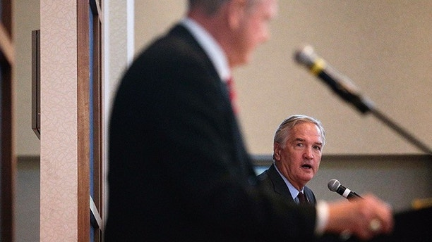 Former Alabama Chief Justice and U.S. Senate candidate Roy Moore, left, listens to Sen. Luther Strange, right, during a debate on Thursday, Sept. 21, 2017, in Montgomery, Ala. (AP Photo/Brynn Anderson)