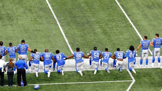 Detroit Lions players take a knee during the national anthem before an NFL football game against the Atlanta Falcons in Detroit, Sunday, Sept. 24, 2017. (AP Photo/Paul Sancya)