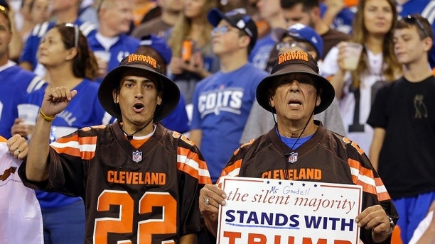 FILE - In this Sunday, Sept. 24, 2017, file photo, Cleveland Browns fans hold a sign following the national anthem before an NFL football game between the Indianapolis Colts and the Cleveland Browns in Indianapolis. Russian internet trolls are exploiting the controversy over NFL players kneeling during the national anthem to stir up divisions in the United States, according to Sen. James Lankford, R-Oka., a member of the Senate intelligence committee said Sept. 27. (AP Photo/Michael Conroy, File)