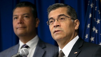 FILE - In this Sept. 5, 2017 file photo, California Attorney General Xavier Becerra, right, flanked by Secretary of State Alex Padilla, speaks to reporters at the Capitol in Sacramento. Becerra filed a lawsuit Monday, Sept. 11, against the Trump administration over its decision to end the Deferred Action for Childhood Arrivals program, or DACA, that protects young immigrants from deportation who were brought to the U.S. illegally as children or by parents who overstayed visas. (AP Photo/Rich Pedroncelli, File)