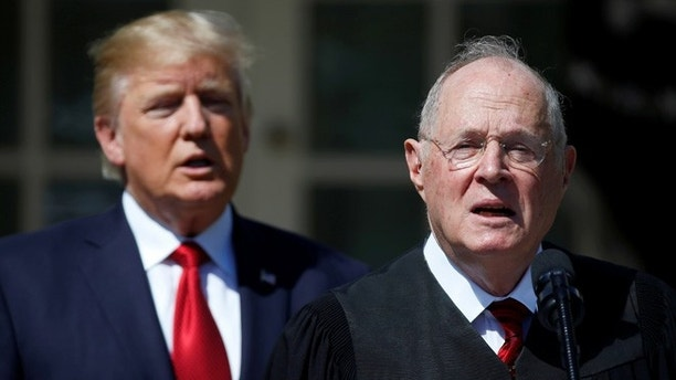 U.S. President Donald Trump listens as Justice Anthony Kennedy speaks before swearing in Judge Neil Gorsuch as an Associate Supreme Court Justice in the Rose Garden of the White House in Washington, U.S., April 10, 2017. REUTERS/Joshua Roberts - RTX34YSY