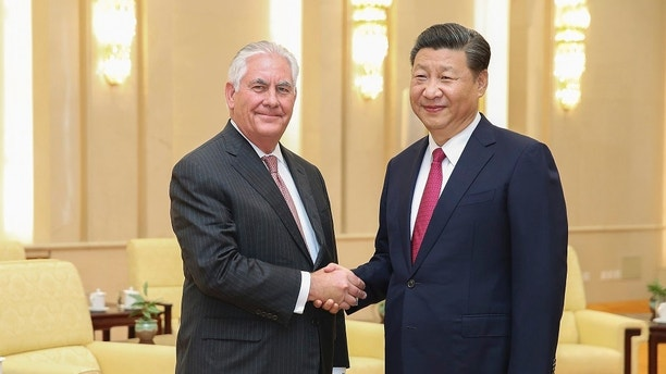 U.S. Secretary of State Rex Tillerson, left, shakes hands with China's President Xi Jinping before their meeting at the Great Hall of the People, Saturday, Sept. 30, 2017, in Beijing. (Lintao Zhang/Pool Photo via AP)