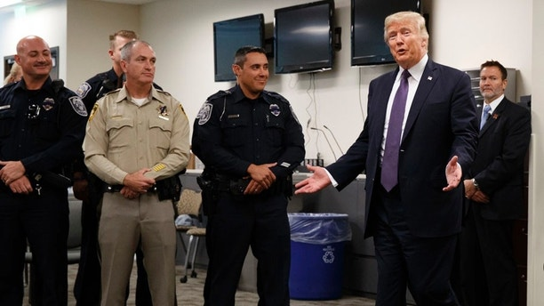 President Donald Trump arrives to meet with first responders at the Las Vegas Metropolitan Police Department, Wednesday, Oct. 4, 2017, in Las Vegas. (AP Photo/Evan Vucci)