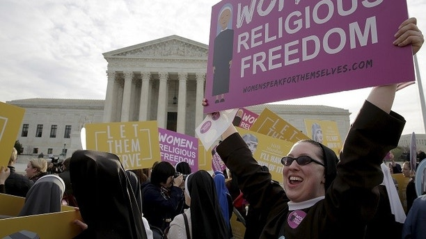 Nuns rally before Zubik v. Burwell, an appeal brought by Christian groups demanding full exemption from the requirement to provide insurance covering contraception under the Affordable Care Act, is heard by the U.S. Supreme Court in Washington, March 23, 2016. REUTERS/Joshua Roberts - GF10000357302