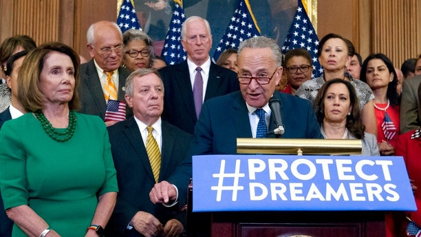 Senate Minority Leader Chuck Schumer of N.Y., accompanied by House Minority Leader Nancy Pelosi of Calif., left, and others members of the House and Senate Democrats, speaks during a news conference on Capitol Hill in Washington, Wednesday, Sept. 6, 2017. House and Senate Democrats gather to call for Congressional Republicans to stand up to President Trump's decision to terminate the Deferred Action for Childhood Arrivals (DACA) initiative by bringing the DREAM Act for a vote on the House and Senate Floor. ( AP Photo/Jose Luis Magana)