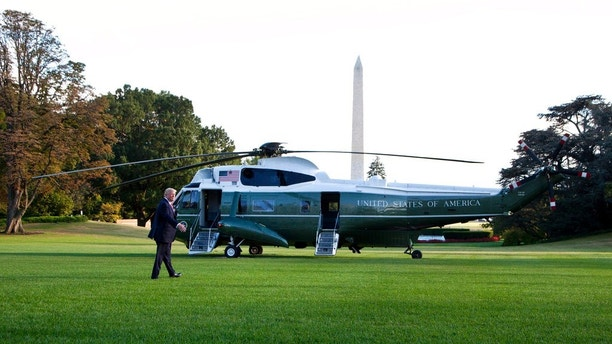 President Donald Trump walks on the South Lawn of the White House in Washington, to board the Marine One for a brief stop at Andrews Air Force Base in Md., on his way to Greensboro, N.C., Saturday, Oct. 7, 2017. (AP Photo/Manuel Balce Ceneta)