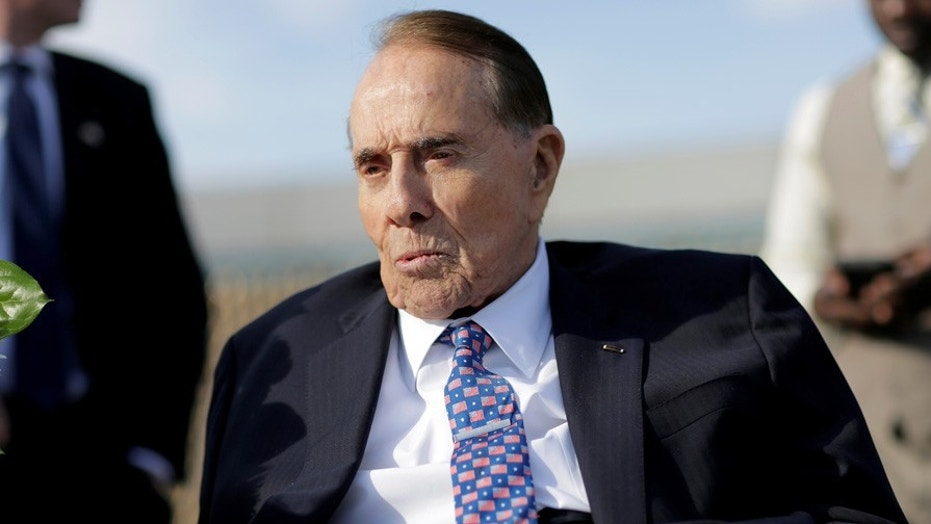 World War Two veteran and former Senate Majority Leader Bob Dole attends Memorial day services at the World War II Memorial in Washington, U.S., November 11, 2016. REUTERS/Joshua Roberts - S1AEUMGVXDAA