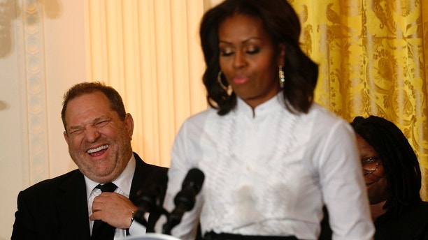 Film producer and studio executive Harvey Weinstein laughs at remarks directed at him by U.S. first lady Michelle Obama as she hosts a workshop at the White House for high school students about careers in film in Washington November 8, 2013. At right is actress Whoopi Goldberg (obscured). 