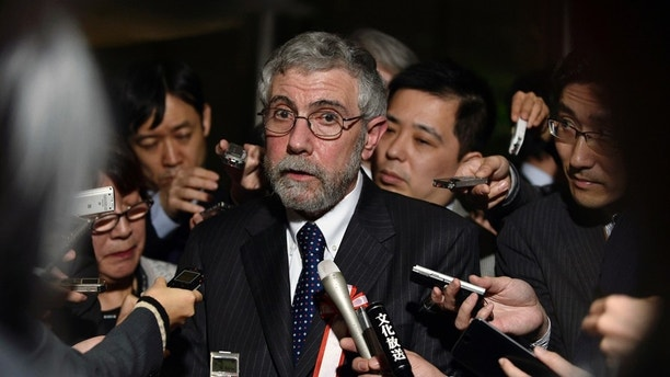 Paul Krugman (C) , Nobel Prize-winning economist and professor emeritus of economics and international affairs at Princeton University, speaks to reporters after a meeting discussing global economy hosted by Japan's Prime Minister Shinzo Abe (not pictured) at Abe's official residence in Tokyo, Japan, March 22, 2016. REUTERS/Franck Robichon/Pool - D1AESTYWYGAA