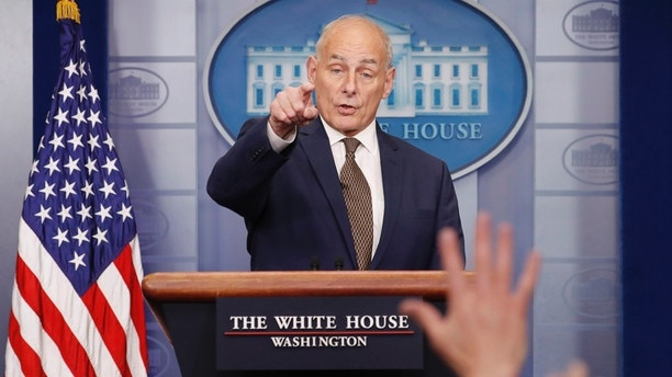 photo image John Kelly declares 'I'm not quitting,' in surprise briefing appearance