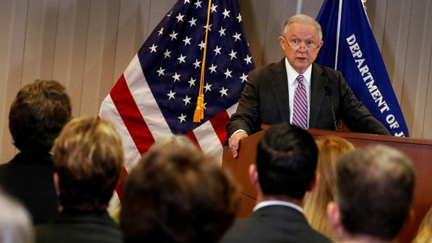U.S. Attorney General Jeff Sessions delivers remarks on the U.S. system for asylum-seekers at the Executive Office for Immigration Review in Falls Church, Virginia, U.S. October 12, 2017.  REUTERS/Jonathan Ernst - RC162568A320