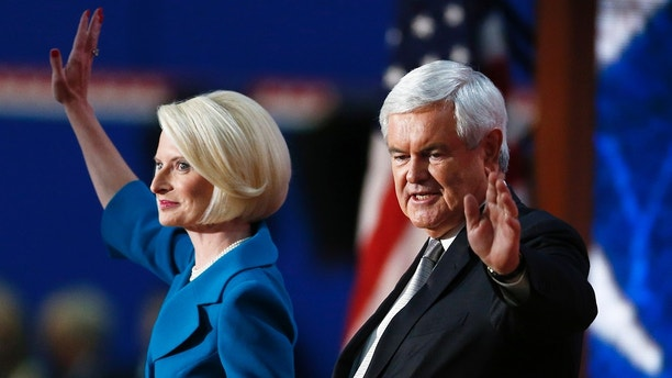 Former House Speaker and former Republican presidential candidate Newt Gingrich and his wiife Callista wave after addressing the final session of the Republican National Convention in Tampa, Florida, August 30, 2012. REUTERS/Jason Reed (UNITED STATES  - Tags: POLITICS ELECTIONS)   - TB3E88V00BMI4