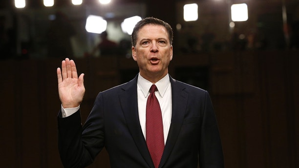 Former FBI Director James Comey is sworn in prior to testifying before a Senate Intelligence Committee hearing on Russia's alleged interference in the 2016 U.S. presidential election on Capitol Hill in Washington, U.S., June 8, 2017. REUTERS/Jonathan Ernst - HP1ED681C66SA