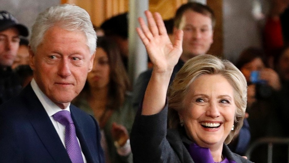 Hillary Clinton and Bill Clinton are seen leaving a hotel in Manhattan, in this Nov. 9, 2016 file photo.