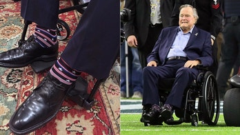 Feb 5, 2017; Houston, TX, USA; President George H. W. Bush and former first lady Barbara Bush are assisted to mid-field for the coin toss ceremony prior to Super Bowl LI between the Atlanta Falcons and the New England Patriots at NRG Stadium. Mandatory Credit: Eric Seals-USA TODAY Sports - 9861245