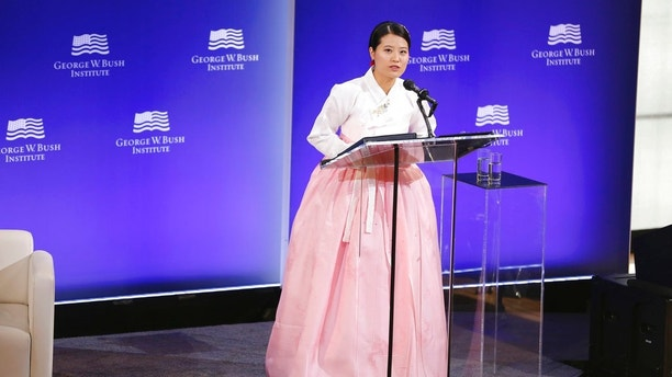 Grace Jo speaks at a forum sponsored by the George W. Bush Institute in New York, Thursday, Oct. 19, 2017. (AP Photo/Seth Wenig)