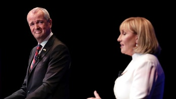 Democratic nominee Phil Murphy, left, listens as Republican nominee Lt. Gov. Kim Guadagno, right, answers a question during a gubernatorial debate at the New Jersey Performing Arts Center, Tuesday, Oct. 10, 2017, in Newark, N.J. (AP Photo/Julio Cortez, Pool)
