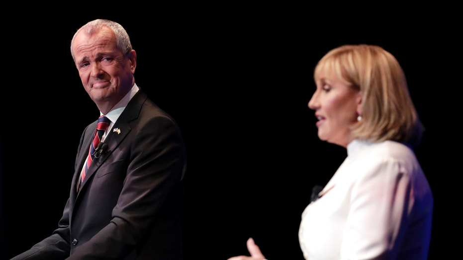 New Jersey gubernatorial candidates Phil Murphy, a Democrat, and Kim Guadagno, a Republican, are seen during their first debate, Oct. 10, 2017.