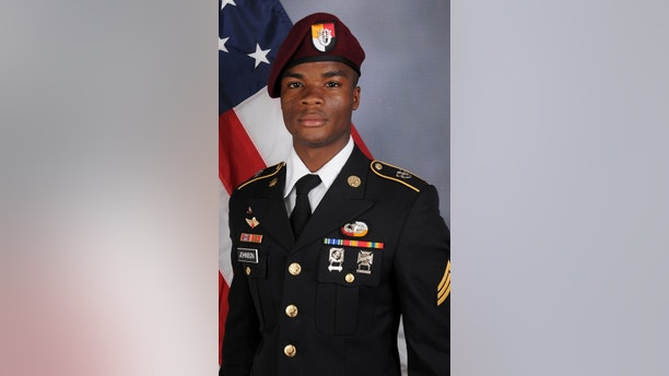 U.S. Army Sergeant La David Johnson, who was among four special forces soldiers killed in Niger, West Africa on October 4, 2017, poses in a handout photo released October 18, 2017.  Courtesy U.S. Army Special Operations Command/Handout via REUTERS   ATTENTION EDITORS - THIS IMAGE WAS PROVIDED BY A THIRD PARTY. - RC12B2744EB0