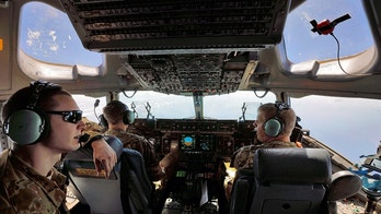 U.S. Air Force pilots man the flight deck of a C-17 transport plane as it flies over the Atlantic Ocean en route to the U.S. Virgin Islands, where it delivered medical supplies and Army medical personnel September 14, 2017. REUTERS/Jonathan Drake - RC16CA41F4C0
