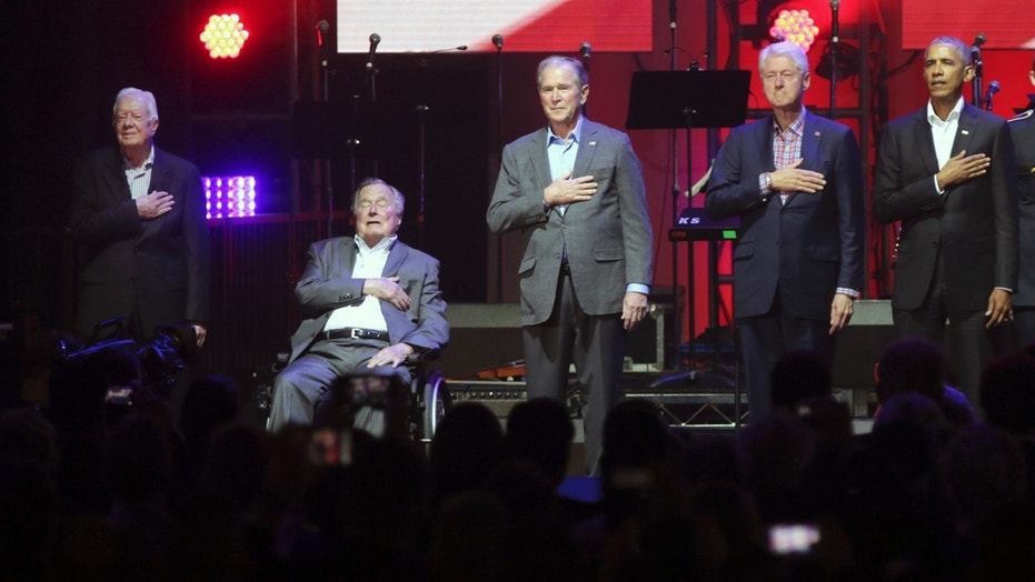 Former Presidents, left to right, Jimmy Carter, George H.W. Bush, George W. Bush, Bill Clinton and Barack Obama appeared together Saturday for the first time since 2013.