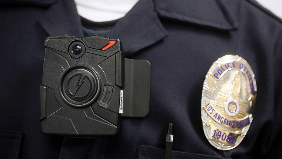 A Los Angeles police officer demonstrates the use of a body camera, Jan. 15, 2014.