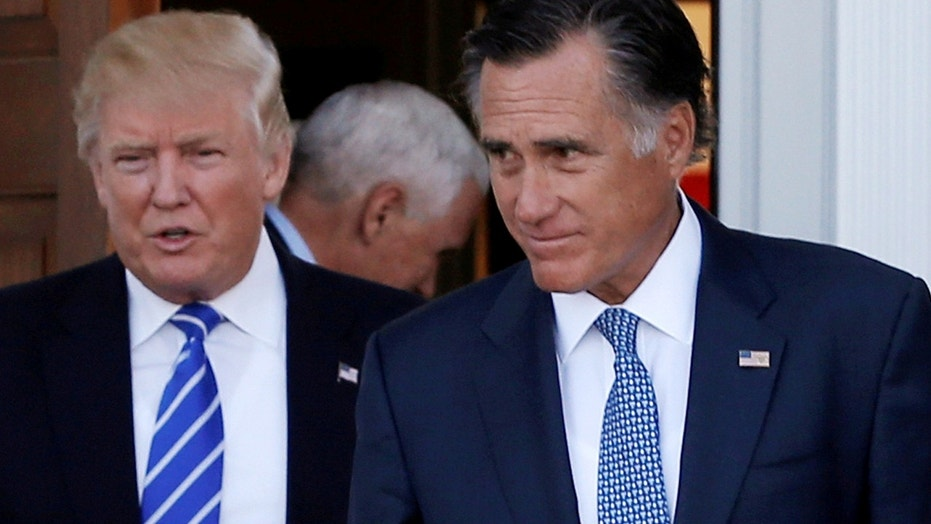 FILE: Then President-elect Trump meets with Mitt Comney in Bedminster, N.J. A newspaper in Utah called on Romney to run for Senate.