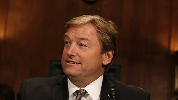Senator Dean Heller (R-NV) arrives at the Senate Judiciary Committee Privacy, Technology and the Law Subcommittee hearing on The Surveillance Transparency Act of 2013 on Capitol Hill in Washington, November 13, 2013. REUTERS/Yuri Gripas (UNITED STATES - Tags: POLITICS MILITARY SCIENCE TECHNOLOGY HEADSHOT) - RTX15BXG
