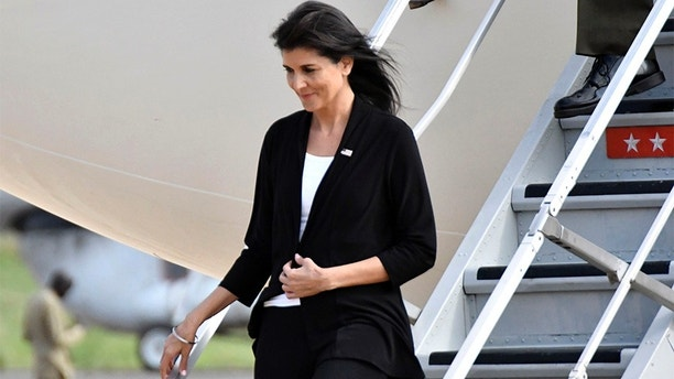 US Ambassador to the United Nations Nikki Haley arrives in Juba, South Sudan, Wednesday, Oct. 25, 2017. The U.S. ambassador to the United Nations, Nikki Haley, has been evacuated from a U.N. camp for displaced people in South Sudan because of a volatile demonstration against President Salva Kiir. An aid worker at the camp says U.N. security guards fired tear gas to disperse the crowd of more than 100 people shortly after Haley left. The ambassador, on a three-country Africa visit, met earlier with Kiir over the country's long civil war. (AP Photo)