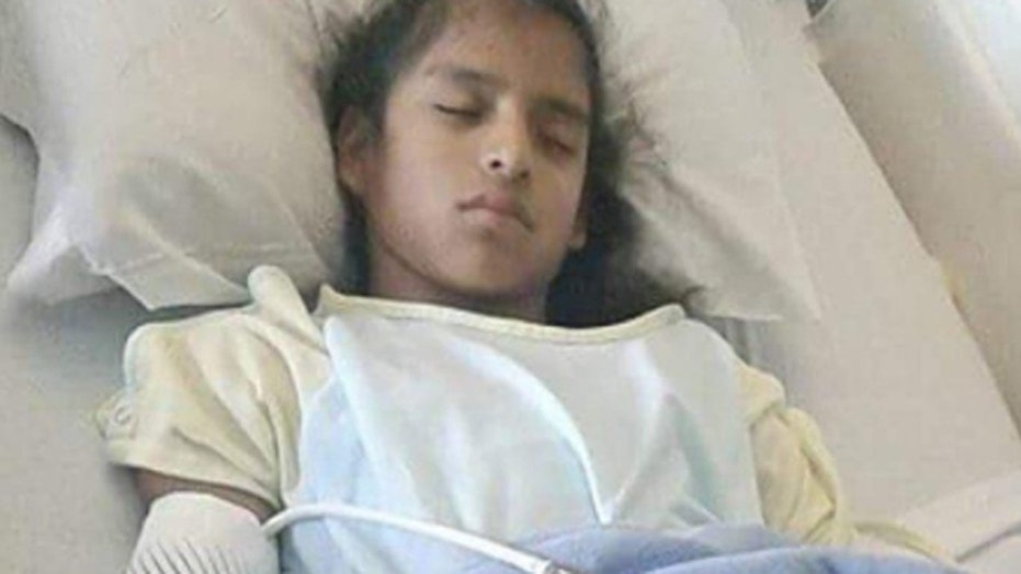 Rosamaria Hernandez, 10, recovers from emergency surgery to treat her cerebral palsy at Driscoll Children's Specialty Center in Laredo, Texas.