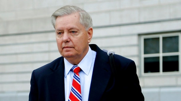 Republican U.S. Sen. Lindsey Graham leaves Martin Luther King, Jr., Federal Courthouse after testifying on behalf of Sen. Bob Menendez, Thursday, Oct. 26, 2017, in Newark, N.J. Menendez is on trial for bribery. (AP Photo/Julio Cortez)