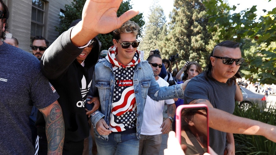 FILE 2017:  Milo Yiannopoulos walks while being escorted away after speaking at the University of California in Berkeley