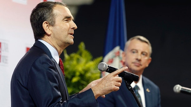 Democratic candidate for governor, Lt. Gov. Ralph Northam, left, gestures during a debate with Republican challenger Ed Gillespie at the University of Virginia-Wise in Wise, Va., Monday, Oct. 9, 2017. (AP Photo/Steve Helber)