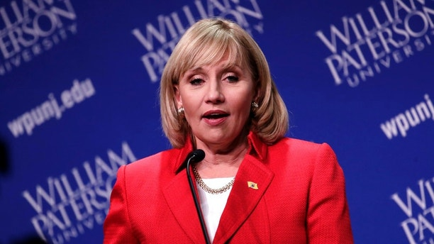 Republican nominee Lt. Gov. Kim Guadagno talks to reporters after participating in a gubernatorial debate against Democratic nominee Phil Murphy at William Paterson University, Wednesday, Oct. 18, 2017, in Wayne, N.J. (AP Photo/Julio Cortez)