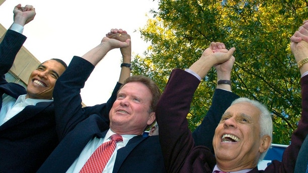 (L-R) U.S. Senator Barack Obama (D-IL), Virginia Democratic senatorial candidate Jim Webb and Richmond Mayor Douglas Wilder join hands at a campaign rally for Webb at Virginia Union University in Richmond, November 2, 2006.  REUTERS/Jonathan Ernst   (UNITED STATES) - GM1DTVXOPFAA