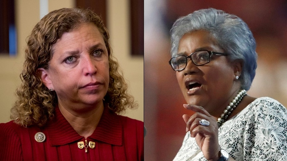 Donna Brazile's campaign tell-all has harsh words for her predecessor at the DNC, Debbie Wasserman Schultz, left.