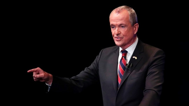 Democratic nominee Phil Murphy answers a question during a gubernatorial debate against Republican nominee Lt. Gov. Kim Guadagno at the New Jersey Performing Arts Center, Tuesday, Oct. 10, 2017, in Newark, N.J. (AP Photo/Julio Cortez, pool)