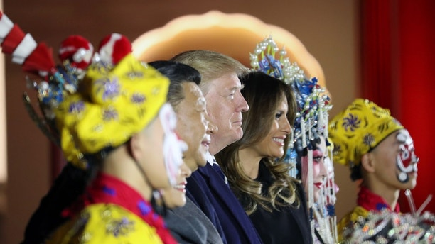 President Donald Trump and first lady Melania Trump stand with Chinese President Xi Jinping during an opera performance at the Forbidden City, Wednesday, Nov. 8, 2017, in Beijing, China. Trump is on a five country trip through Asia traveling to Japan, South Korea, China, Vietnam and the Philippines. (AP Photo/Andrew Harnik)