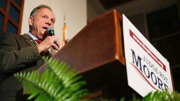 Former Alabama Chief Justice and U.S. Senate candidate Roy Moore speaks to supporters Tuesday, Aug. 15, 2017, in Montgomery, Ala., after he forced a Senate primary runoff with Sen. Luther Strange to fill the U.S. Senate seat previously held by Attorney General Jeff Sessions. (AP Photo/Brynn Anderson)